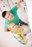 Smiling couple doing renovations at home Royalty Free Stock Photography