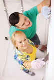Smiling couple doing renovations at home Royalty Free Stock Image