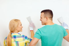 Smiling couple doing renovations at home Stock Image