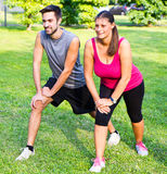 Smiling couple doing streching in the park Royalty Free Stock Image