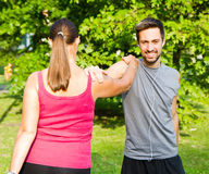 Smiling couple doing streching in the park. A smiling couple doing streching in the park Royalty Free Stock Photo