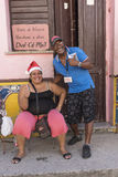 Smiling couple doing thumbs up Havana stock image