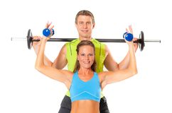 Smiling couple doing weight lifting exercise stock image