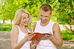 Smiling couple dressed in white Stock Photo