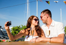 Smiling couple drinking champagne at cafe Royalty Free Stock Images