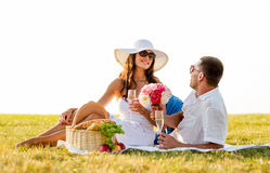 Smiling couple drinking champagne on picnic Stock Photos