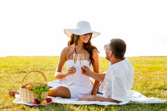 Smiling couple drinking champagne on picnic Stock Photo