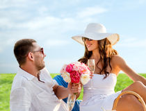 Smiling couple drinking champagne on picnic Royalty Free Stock Photo