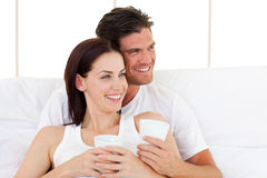 Smiling couple drinking coffee royalty free stock images