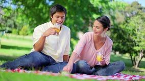 Smiling couple drinking glasses of orange juice Royalty Free Stock Image