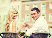 Smiling couple drinking wine in cafe Royalty Free Stock Images