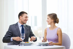 Smiling couple eating appetizers at restaurant Royalty Free Stock Photo