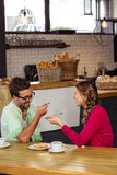 Smiling couple eating cake Stock Photos