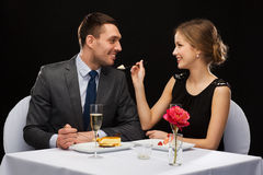 Smiling couple eating dessert at restaurant Stock Image