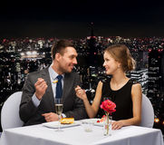 Smiling couple eating dessert at restaurant Stock Images