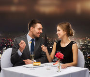 Smiling couple eating dessert at restaurant Stock Photo