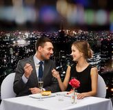 Smiling couple eating dessert at restaurant Royalty Free Stock Image