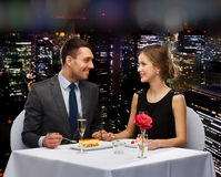Smiling couple eating dessert at restaurant Stock Photos