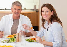 Smiling couple eating dinner Stock Photos