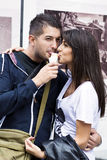Smiling couple eating ice cream on the street Stock Image