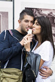 Smiling couple eating ice cream on the street Royalty Free Stock Image