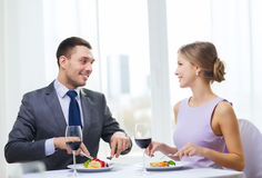 Smiling couple eating main course at restaurant Stock Photography