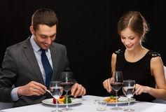 Smiling couple eating main course at restaurant Royalty Free Stock Photo