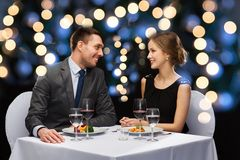 Smiling couple eating main course at restaurant Royalty Free Stock Image