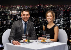 Smiling couple eating main course at restaurant Royalty Free Stock Photography