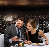 Smiling couple eating main course at restaurant Royalty Free Stock Images