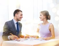 Smiling couple eating sushi at restaurant Royalty Free Stock Photo
