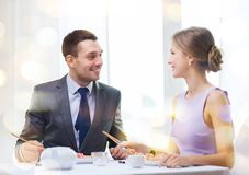 Smiling couple eating sushi at restaurant Royalty Free Stock Image