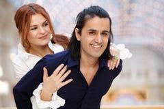 Smiling couple, she embrace him Stock Images