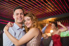 Smiling couple embracing each other in bar Royalty Free Stock Images