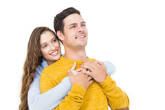 Smiling couple embracing and looking away Stock Photo
