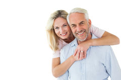 Smiling couple embracing and looking at camera Stock Photography
