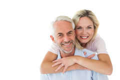 Smiling couple embracing and looking at camera Stock Photos