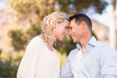 Smiling couple embracing and looking at each other intensively Royalty Free Stock Images