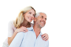 Smiling couple embracing and looking Royalty Free Stock Image