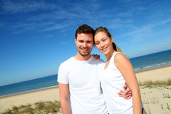 Smiling couple embracing outdoors on the beach Stock Images