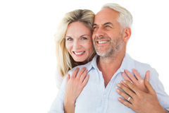 Smiling couple embracing with woman looking at camera. Smiling couple embracing with women looking at camera on white background Stock Photography