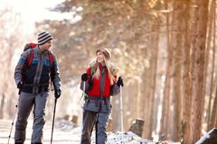 Smiling couple enjoy while hiking in nature Royalty Free Stock Photo