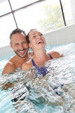 Smiling couple enjoying jacuzzi Royalty Free Stock Photos