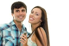 Smiling couple enjoying music together Royalty Free Stock Photos