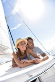 Smiling couple enjoying on a sailing trip Royalty Free Stock Photography