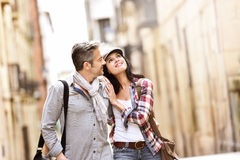 Smiling couple enjoying walking tour Royalty Free Stock Images