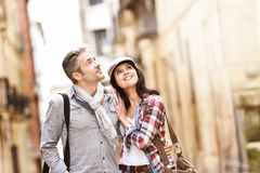 Smiling couple enjoying walking tour Stock Images