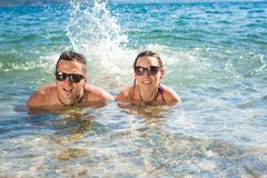 Smiling couple enjoying in water Royalty Free Stock Photo