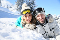 Smiling couple enjoying the winter holidays in snow royalty free stock photography