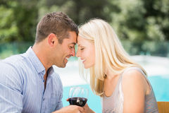 Smiling couple with eyes closed while toasting red wine Royalty Free Stock Photos